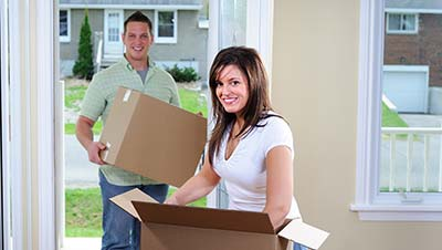 Couple moving in after their local move with Great Nation Moving.