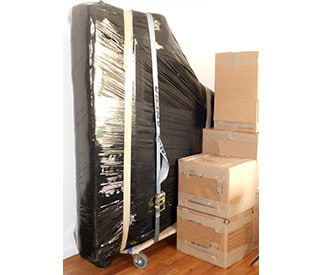 Affordable Special Items storage services - wrapped piano